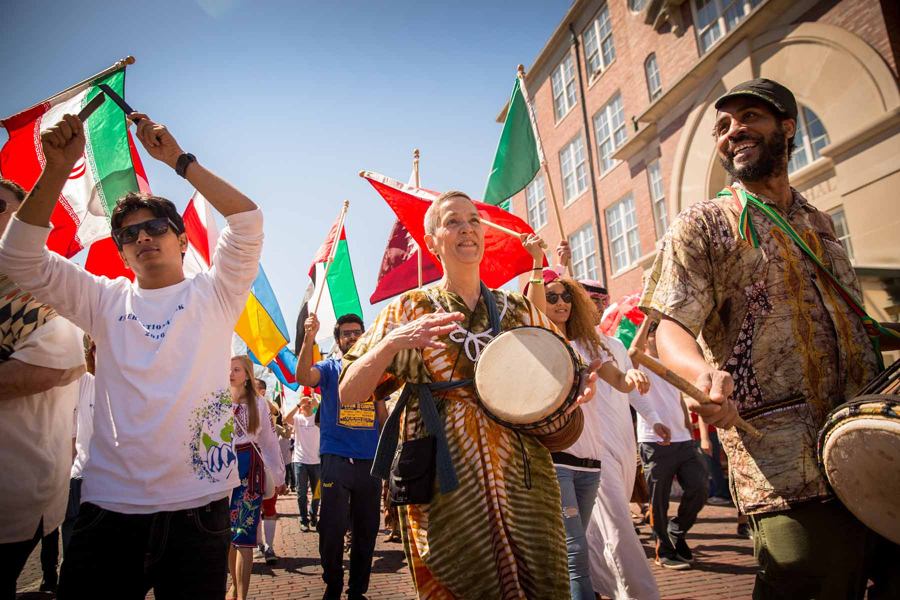 Participants in the annual International Street Fair parade