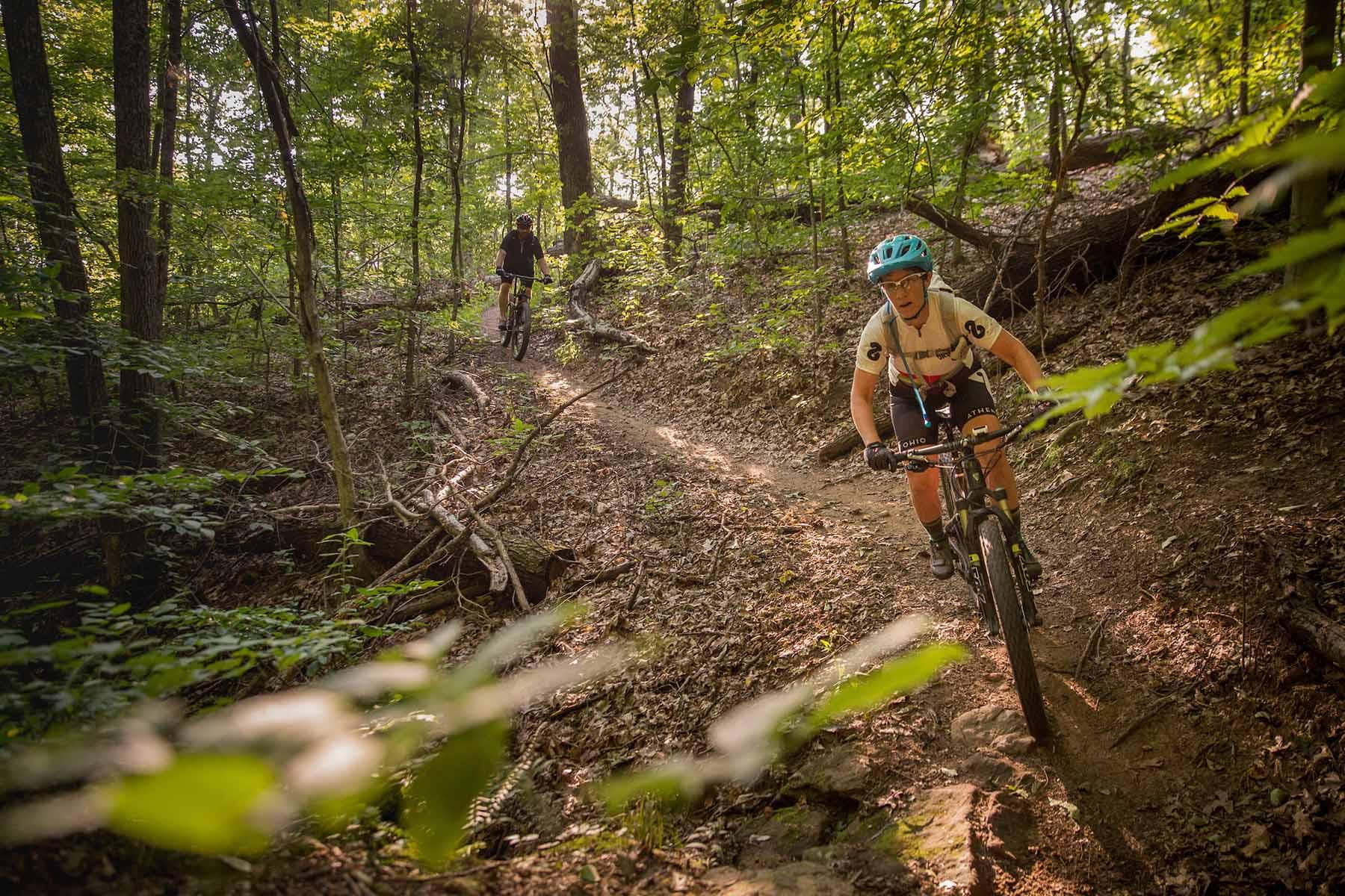 Mountain biking on Sundown Trail at Strouds Run State Park in Athens, Ohio on August 28, 2018