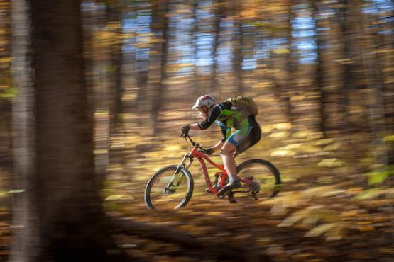 Mountain biker on the trails of Sells Park in Athens, Ohio