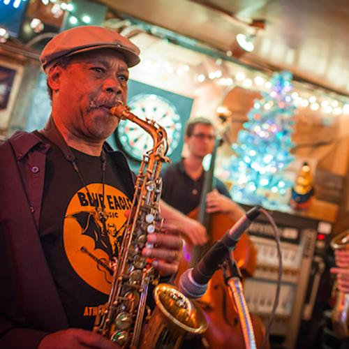 Musicians play saxophone and other instruments during a live performance at Tony's Tavern.