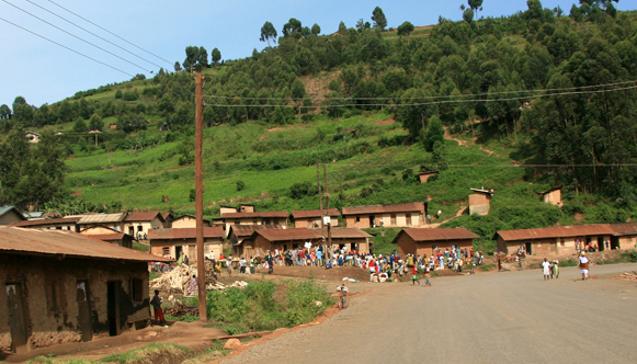 Rural town in Africa, with houses in the background.