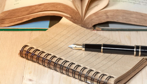 Rhetoric and Composition book and pen
