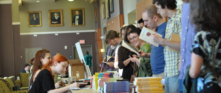 Campus and community members peruse a book table at the Spring Literary Festival.