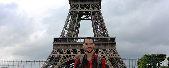 Student standing in front of Eiffel Tower