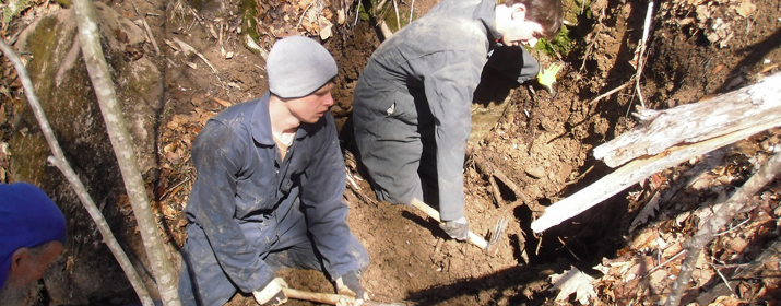 Students work on digging a blowhole discovered using a passive infrared camera.