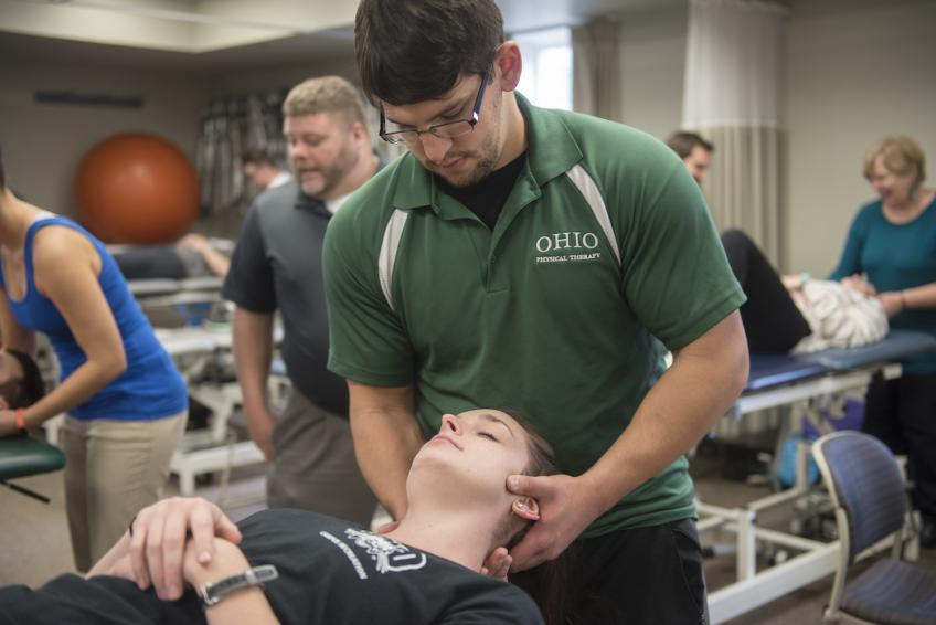 students practicing physical therapy techniques