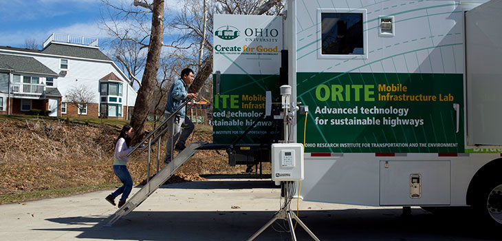 ORITE Mobile Infrastructure lab in parking lot, with two people walking up a staircase to the back door of the trailer