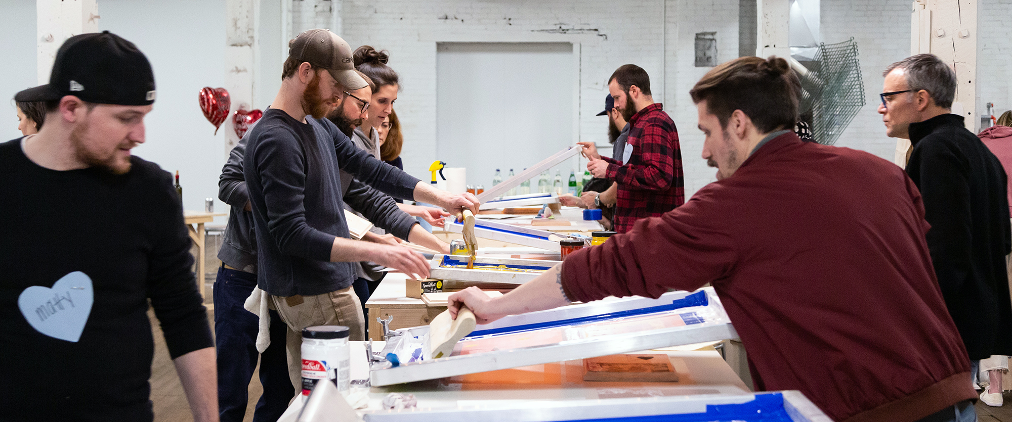 People screen printing at Columbus Printed Arts Center