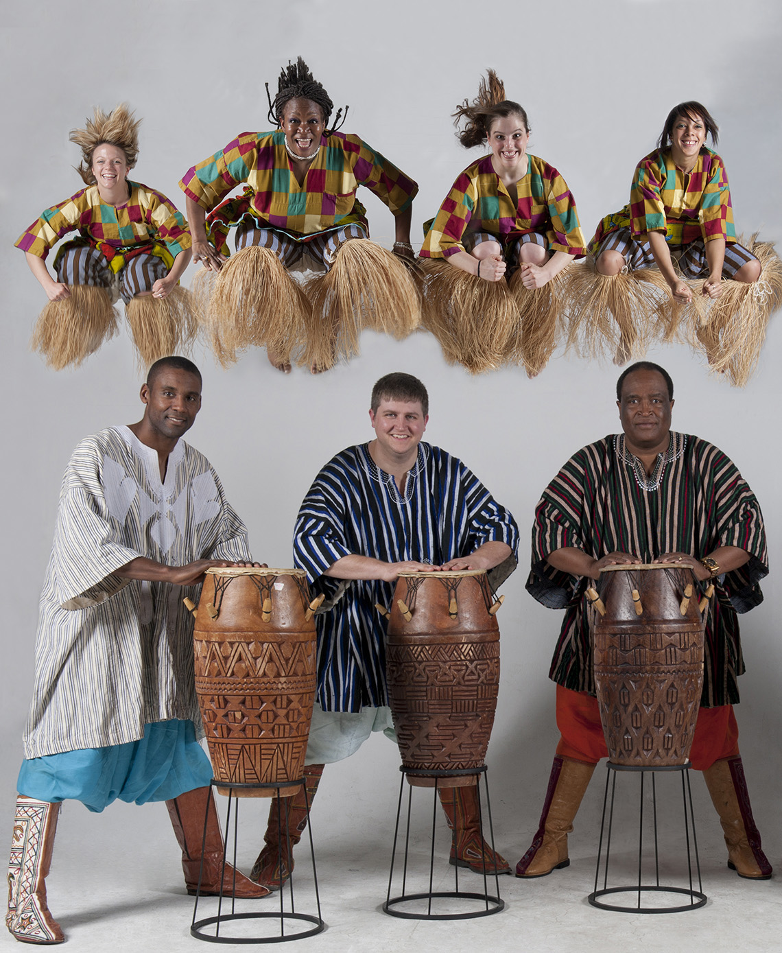 Azaguno: Musicians laying drums with dancers.