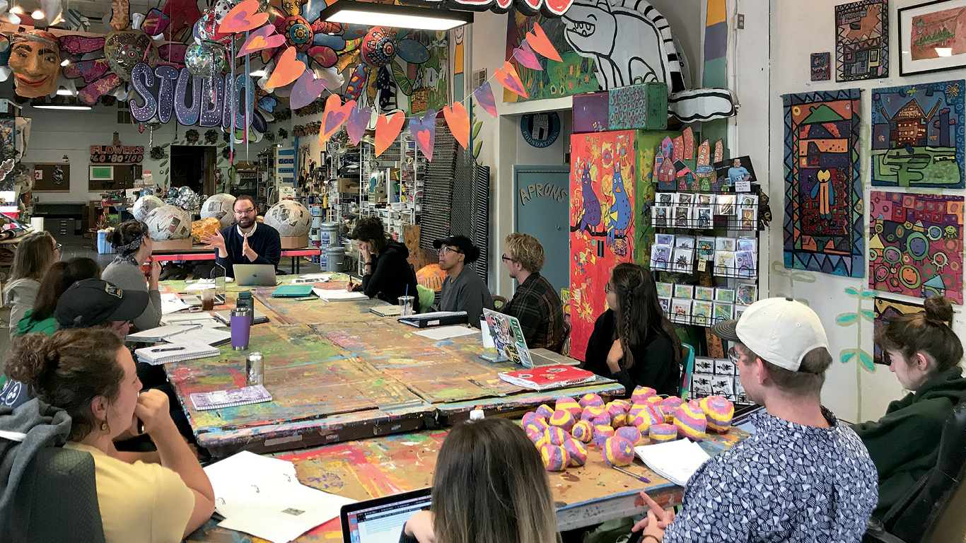Sam Dodd leads a discussion with students in his 30 Mile Studio course at Passion Works Studio in Athens in fall 2018.