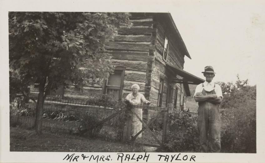 Photograph of Mr. & Mrs. Ralph Taylor outside their home near the Acadia Coal Mine in Rome Township.