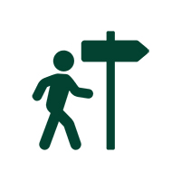 Icon of man walking and a sign pointing to the right