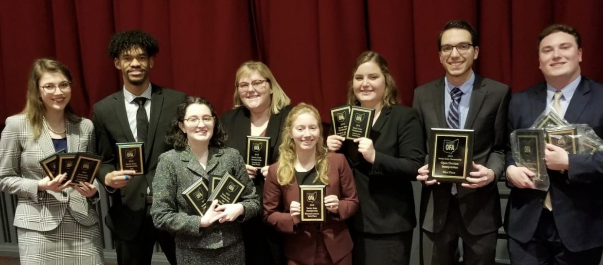 group of people with awards