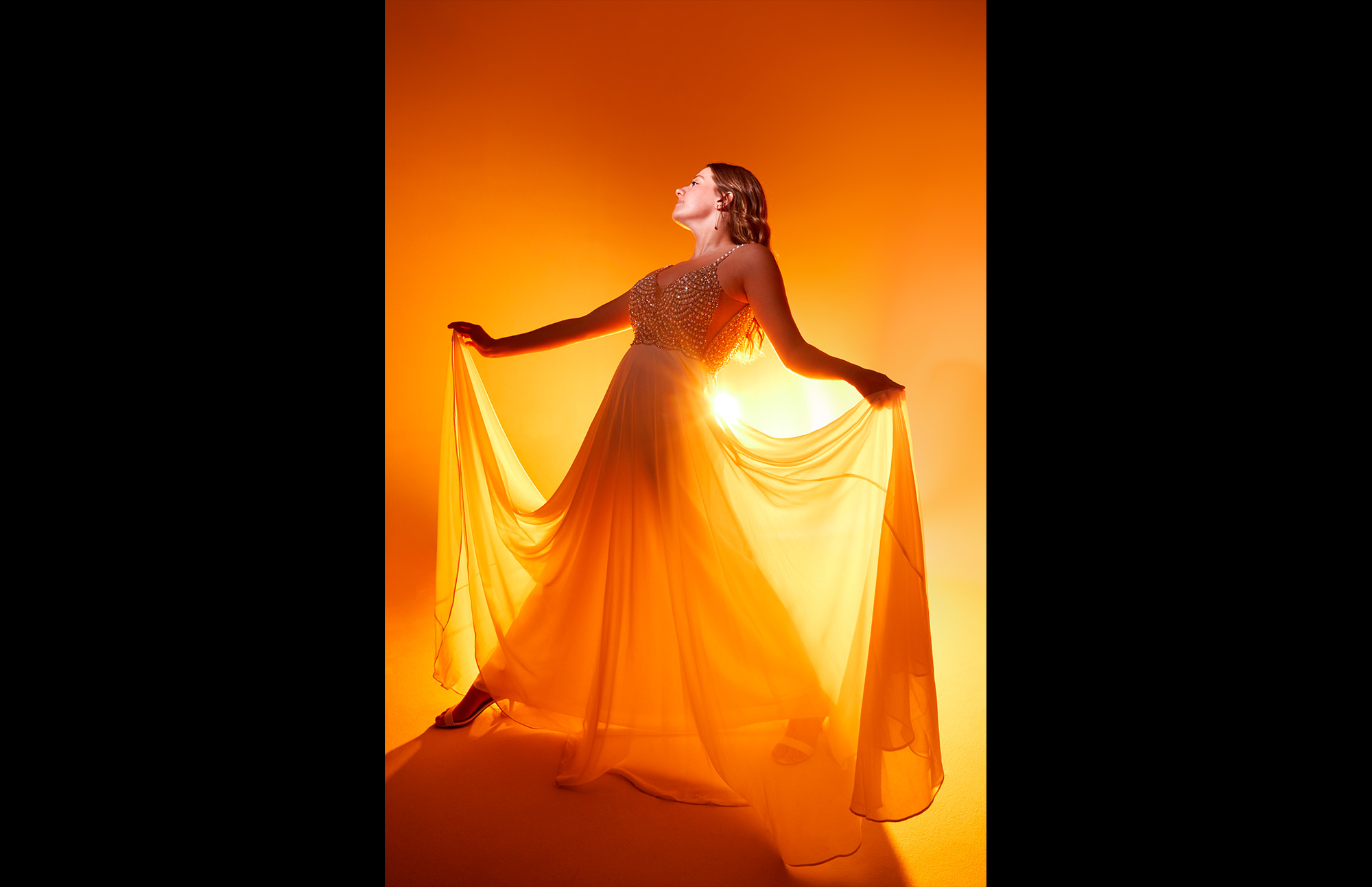 woman in studio with orange light