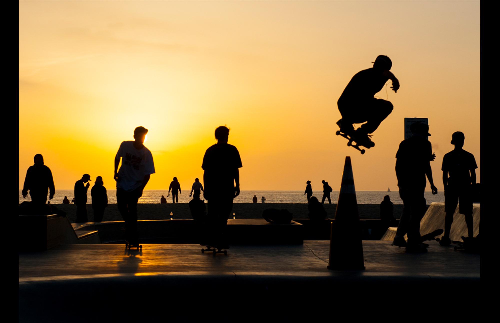 skateboarders' silhouettes