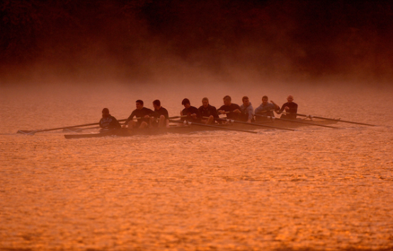 The OHIO Crew rowing team at Dow Lake at sunrise in Athens, Ohio