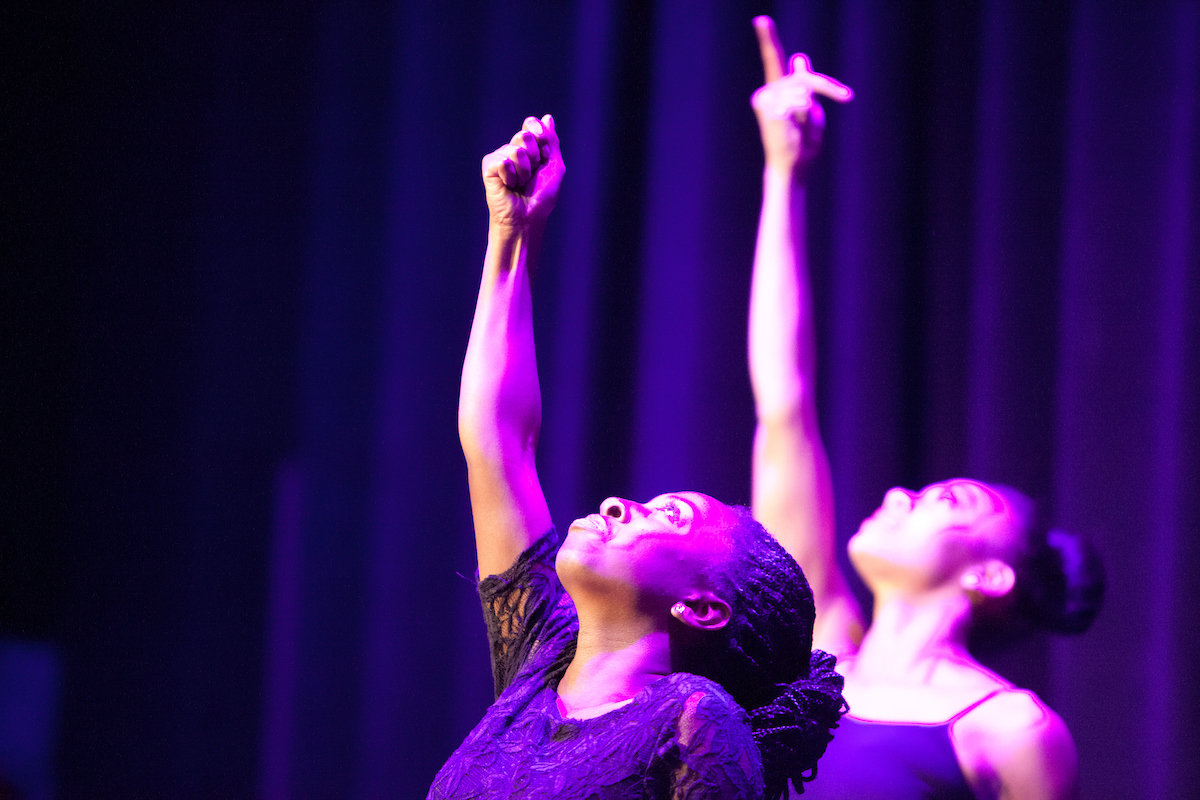 Image of two stage performers during a Black History Month production