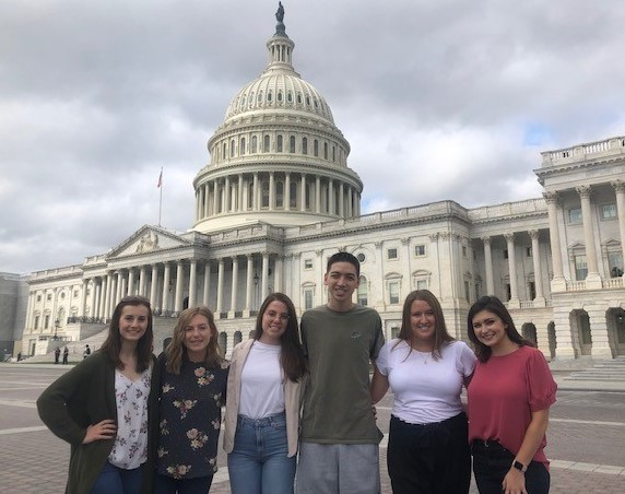 Photo of students on the capital internship program in front of the capital building