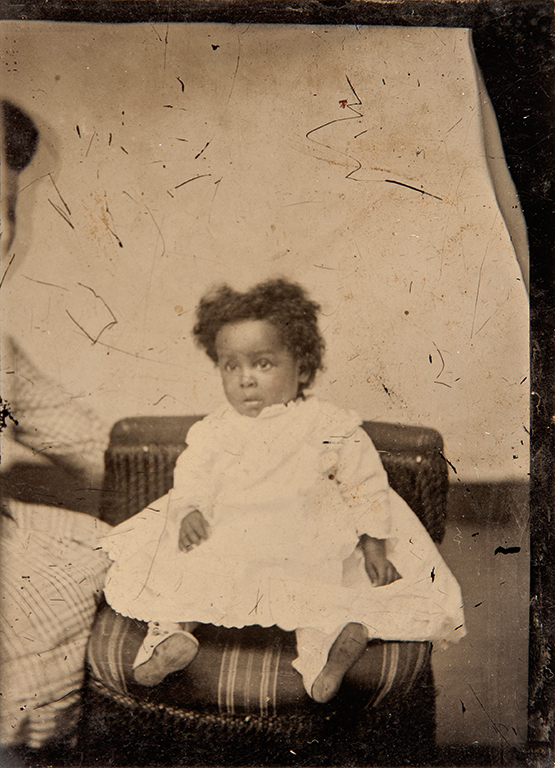 "An image collected by Laura Larson that is representative of the ""hidden mother"" photography of the late 19th century."