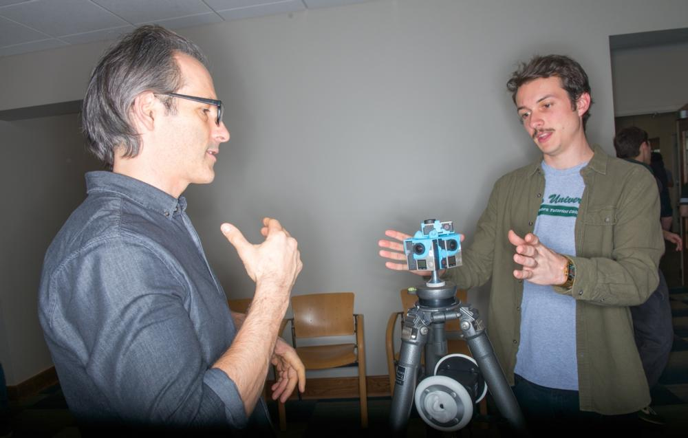 Two men working with a camera