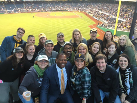 group of people at baseball game