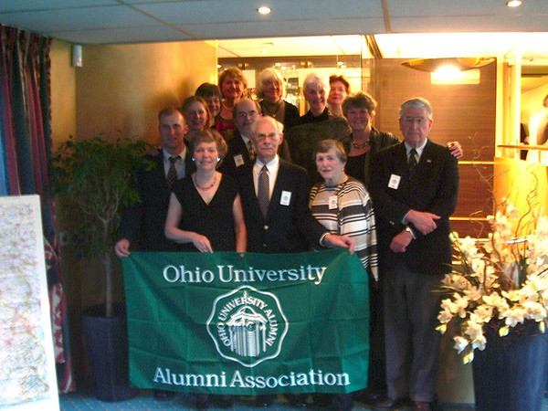 "People holding a banner that reads, ""Ohio University Alumni Association"""
