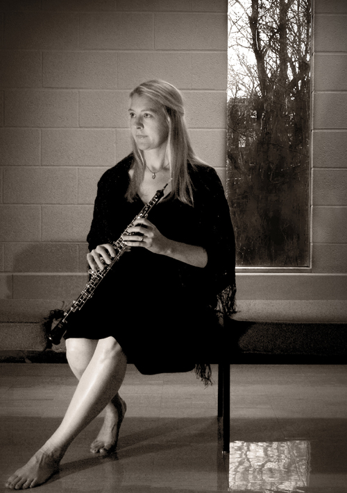 Michele Fiala sitting with an oboe