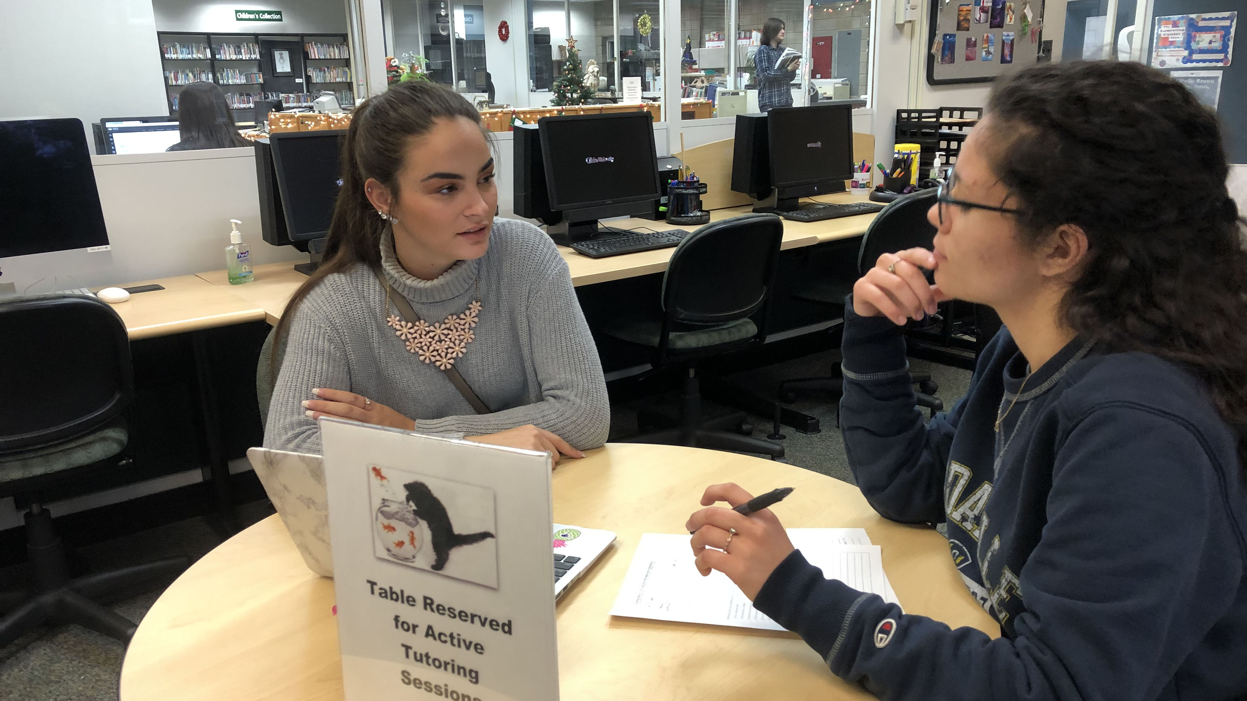 Tutor helping student in the Academic Success Center