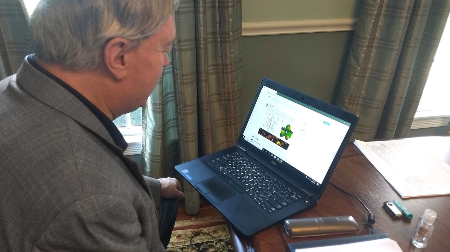 President Nellis looking at his laptop