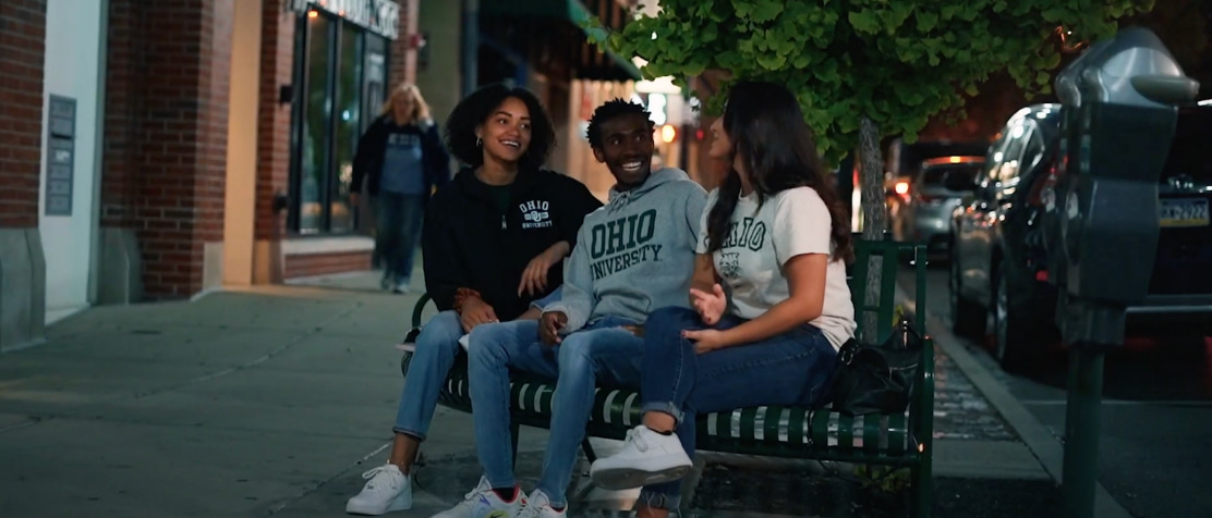 three students sitting on a bench in Athens, Ohio
