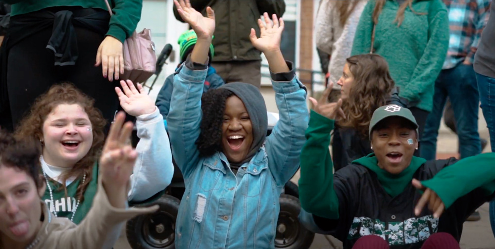 Ohio University students cheer while watching a parade