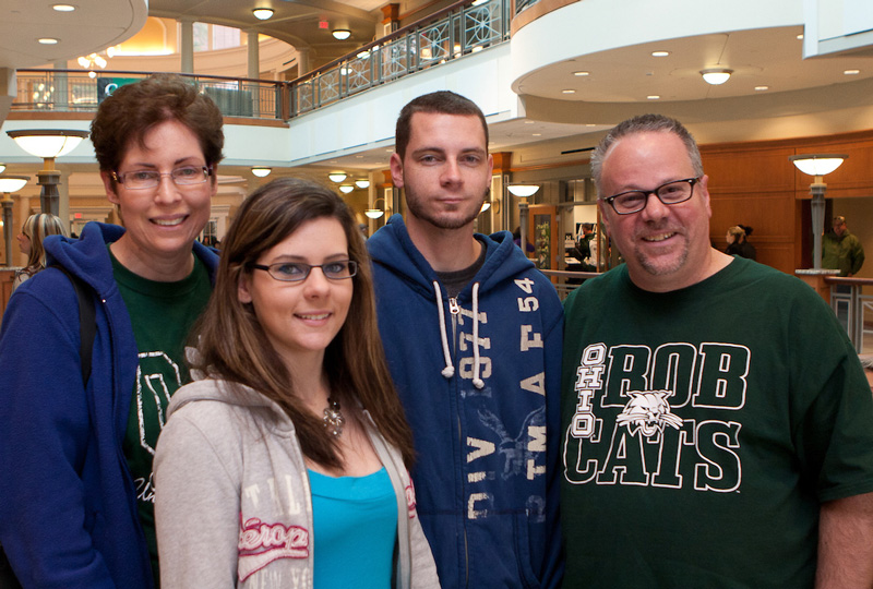 Bobcat students pose for a photo with their parents in Baker Center during Ohio University Parents Weekend