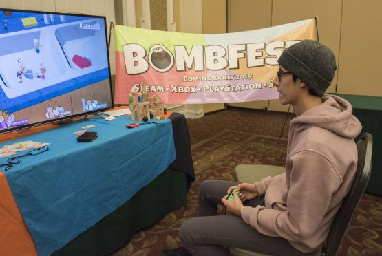 A student plays a new video game called Bombfest
