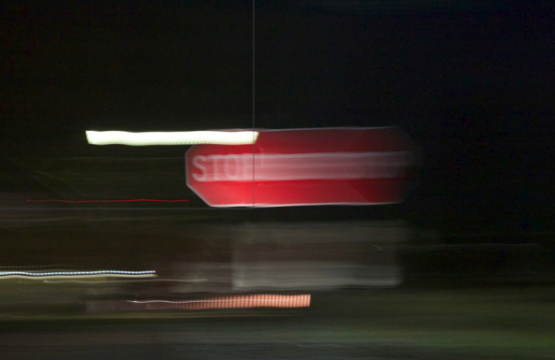 A blurred image of a stop sign.