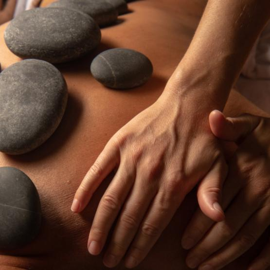 Use of hot stones can quickly warm the fascia, allowing for a deep tissue massage