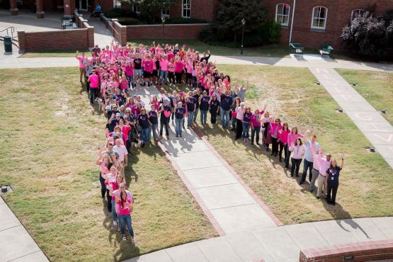 Southern campus staff form pink ribbon