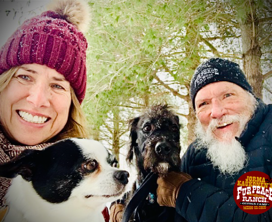 Jorma and Vanessa Kaukonen pose with their dogs outside