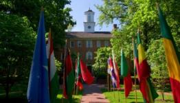 Manasseh Cutler Hall with flags in front of it