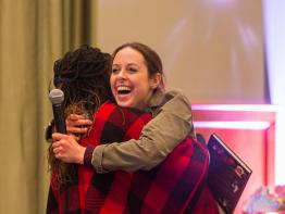 Students hug at the Women in Graduate School Conference 2020