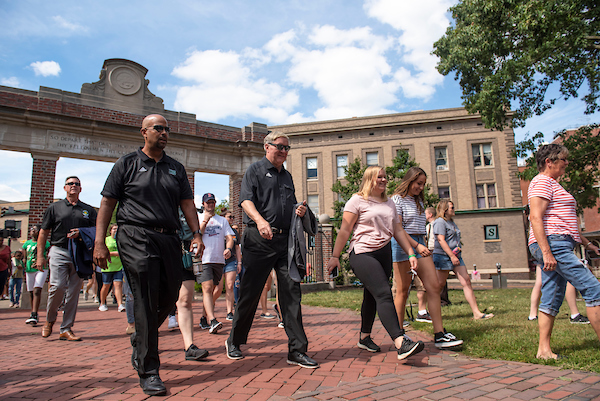 President Nellis walks through the gate with students during the 2019 Involvement Fair. Photo by Hannah Ruhoff