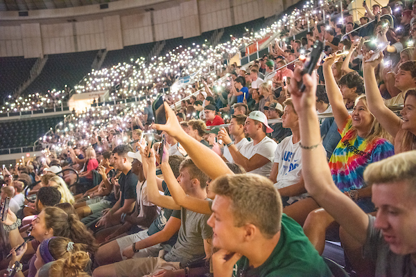 Students participate in an informal survery by holding up their cellphones at First Year Student Convocation. Photo by Ben Siegel