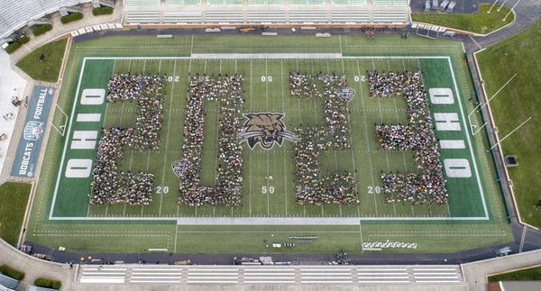 Students pose for a 2023 class photo at Peden Stadium. Photo by Ben Siegel