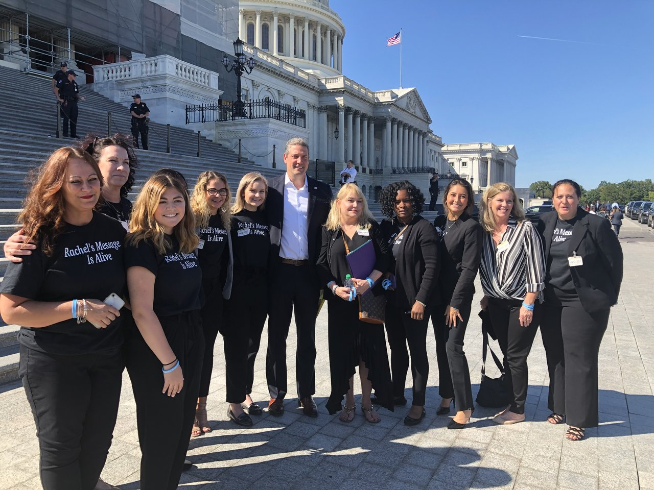 The Rachel's Angels group poses for a photo with Rep. Tim Ryan (D-OH). Ohio University student Katie Bender is third from the right.