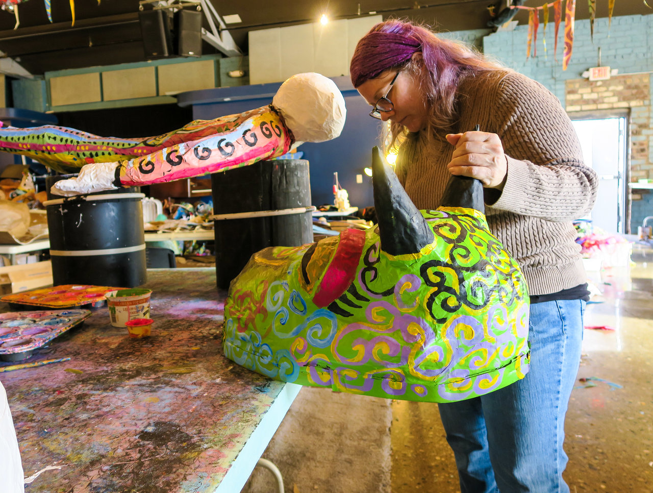 Artist Logan Madison works on a piece for the 2019 Honey for the Heart parade. Photo by Alaina Bartel