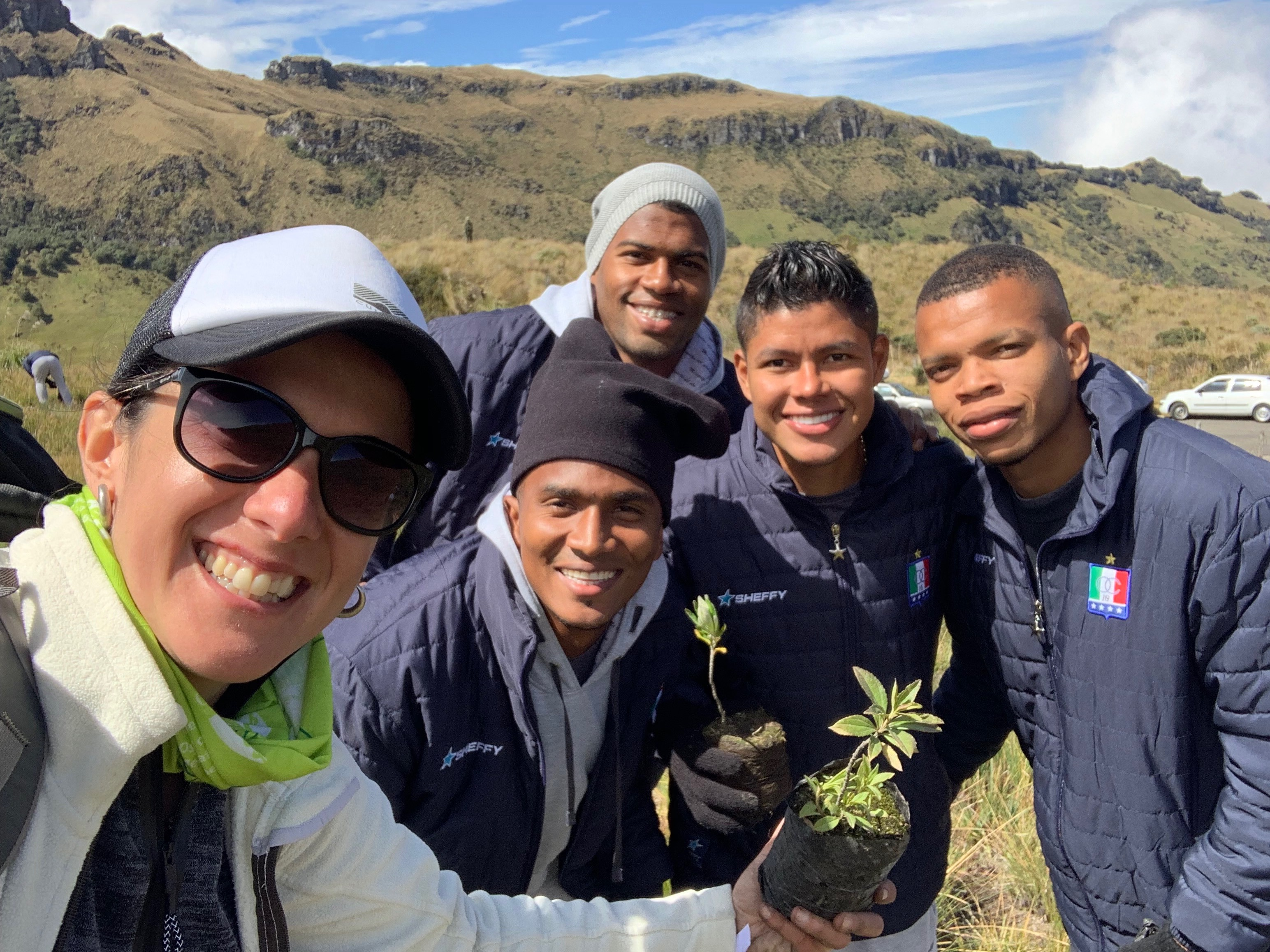 Members of the Colombian national soccer team helped the research team plant trees in Colombia.