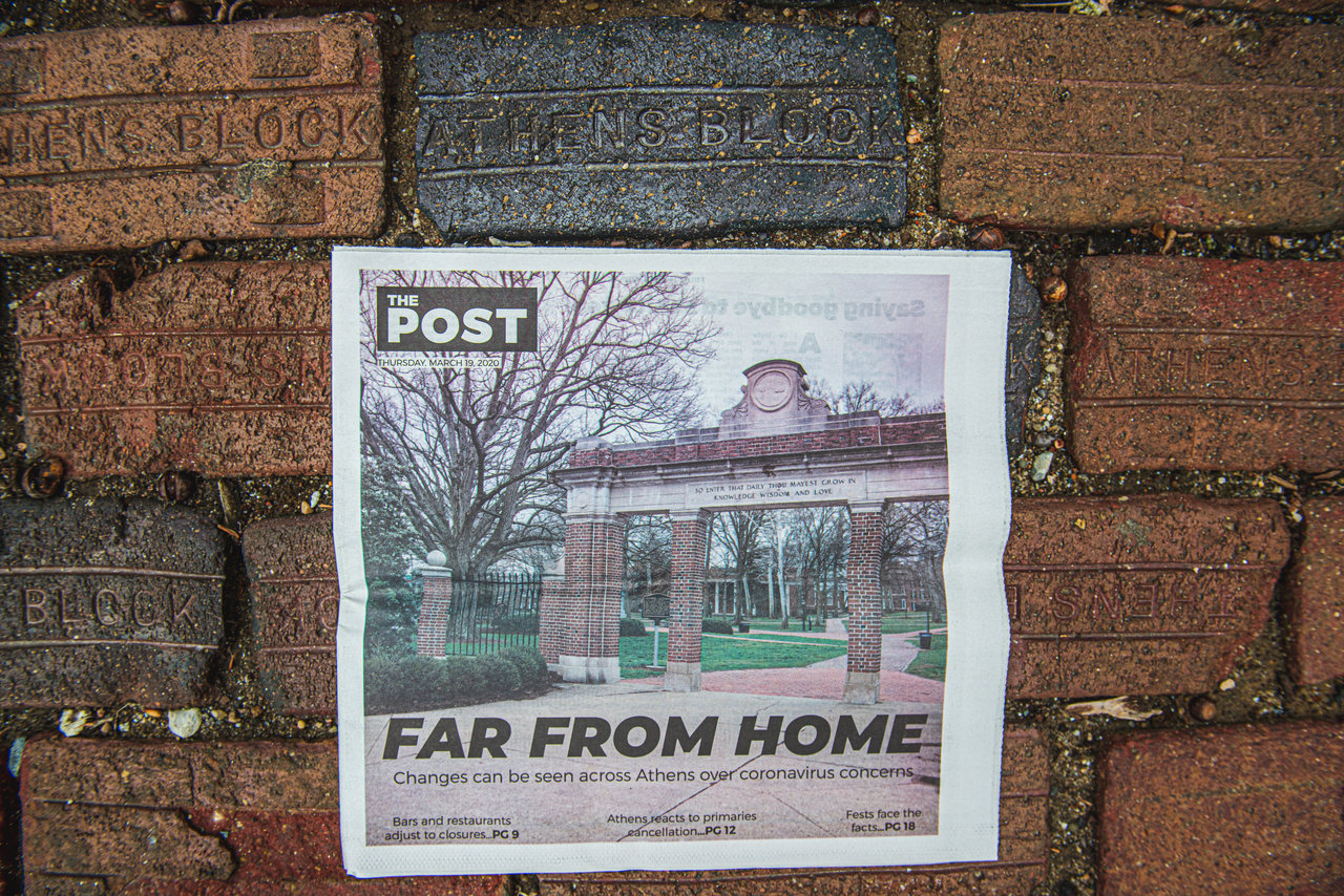 The Post's latest print edition focusing on coronavirus is displayed among the bricks on OHIO's Athens Campus.