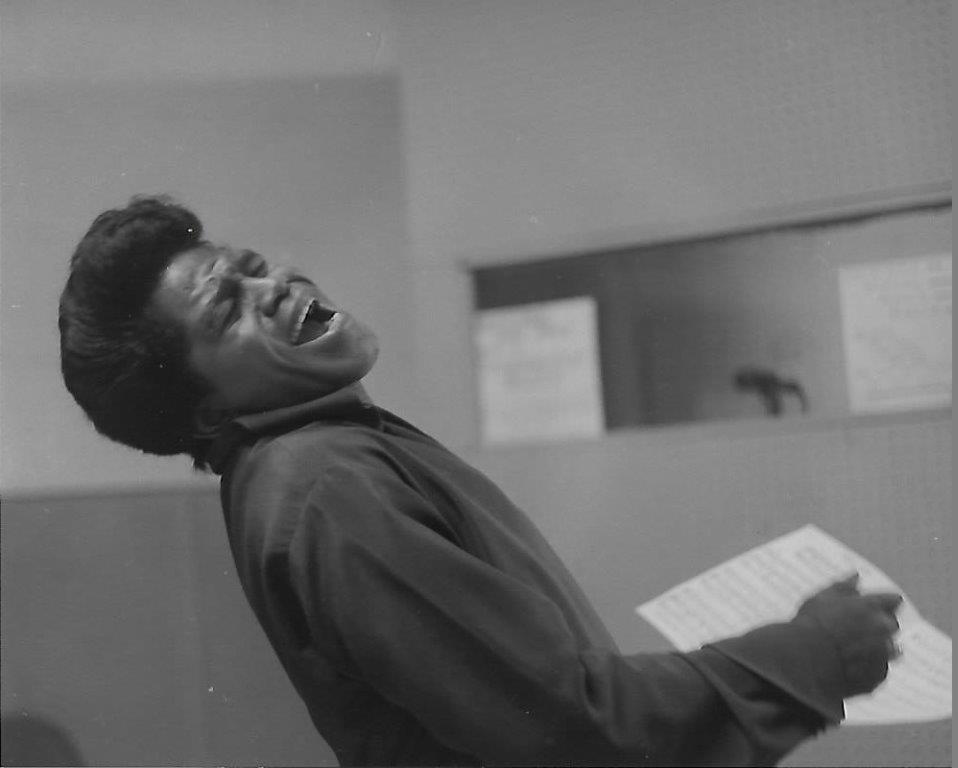 A 1966 black and white photo of James Brown taken by Chuck Stewart