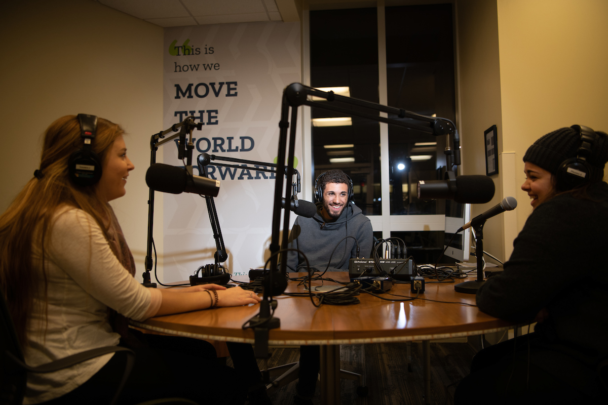 Students making a podcast in studio