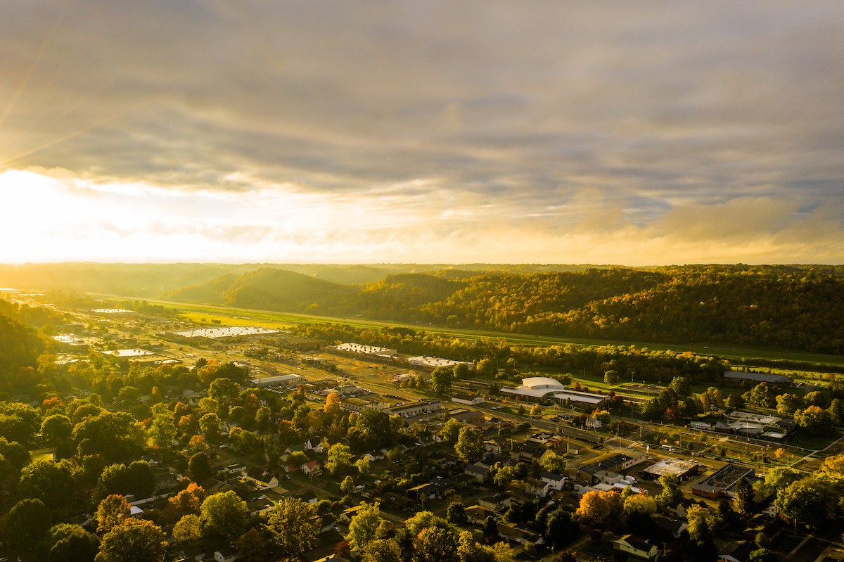 Aerial photo of the sun gracing the hills of Athens, Ohio