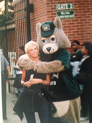 Terri Morris Stagi, BSJ '77, poses for a photo outside of Peden Stadium with Ohio University's mascot – before he was named Rufus and had a new look.